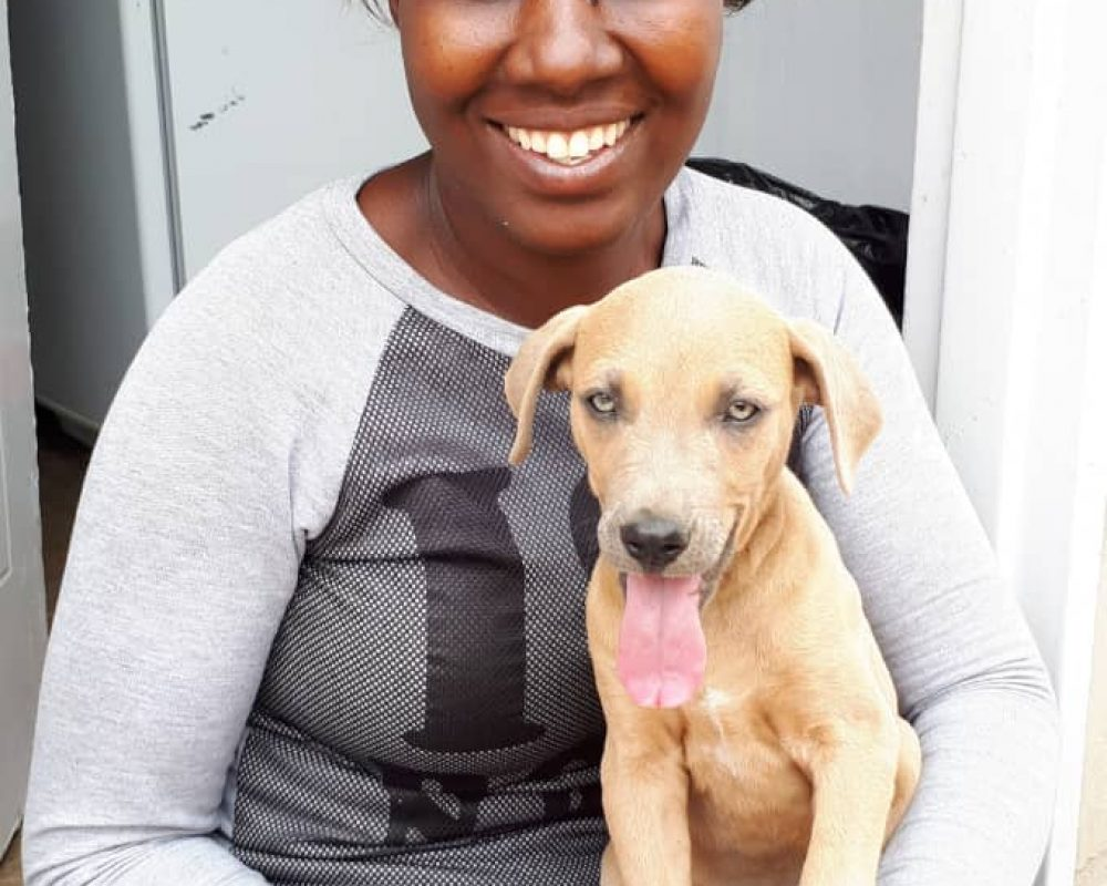Lady with puppy for outreach 2018