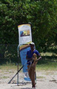Man brinig dog to outreach banner in background